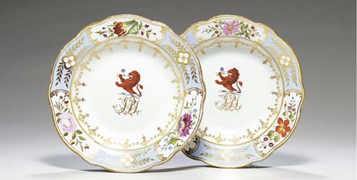 A PAIR OF CHAMBERLAIN'S WORCESTER PALE-BLUE GROUND CRESTED SOUP PLATES,