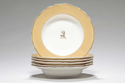 TWELVE ENGLISH APRICOT-GROUND CRESTED SOUP PLATES,