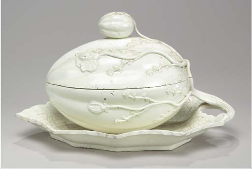 AN ENGLISH CREAMWARE MELON TUREEN AND COVER ON FIXED LEAF-SHAPE STAND,