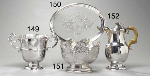 A SILVER TWO-HANDLE CUP,