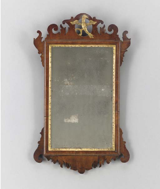 AN AMERICAN MAHOGANY AND PARCEL-GILT MIRROR,