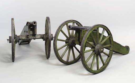 A PAIR OF SWEDISH CAST IRON AND GREEN-PAINTED CANNONS,