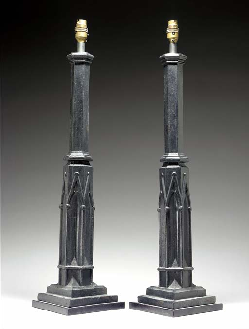 A PAIR OF GOTHIC STYLE CAST IRON LAMPS,
