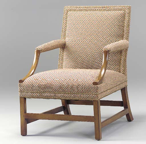 A GEORGE III STYLE MAHOGANY LIBRARY ARMCHAIR,