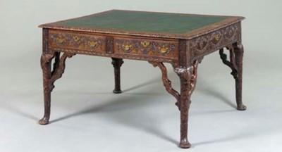 A CARVED MAHOGANY WRITING TABL