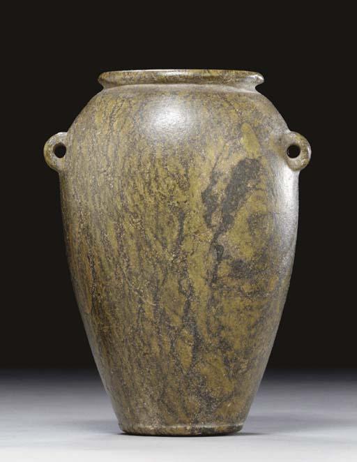 AN EGYPTIAN GREEN SERPENTINE J