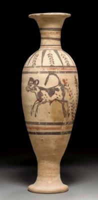 AN EGYPTIAN POTTERY VASE