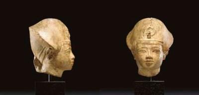 AN EGYPTIAN LIMESTONE HEAD OF