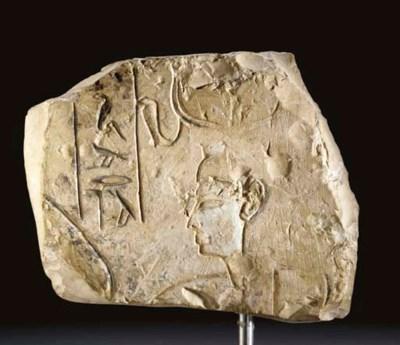 AN EGYPTIAN PAINTED LIMESTONE