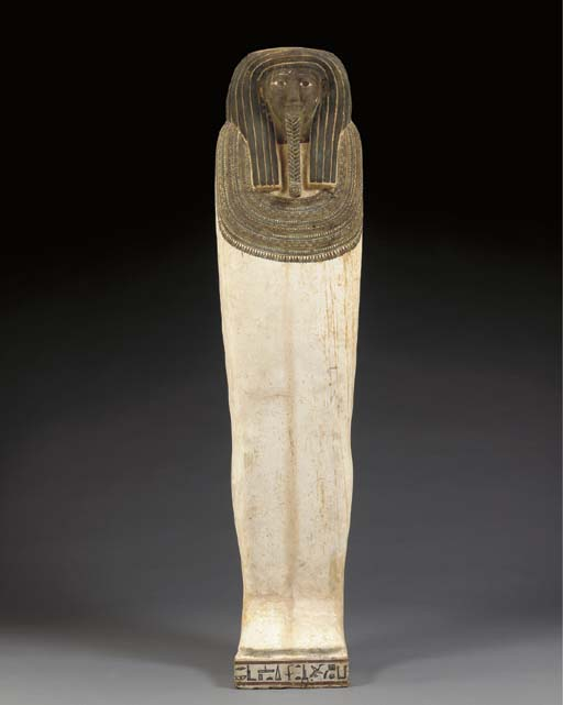 AN EGYPTIAN WOOD SARCOPHAGUS L
