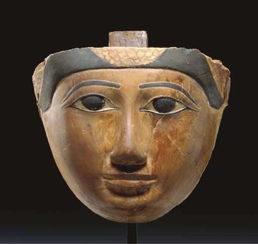 AN EGYPTIAN POLYCHROME WOOD MA