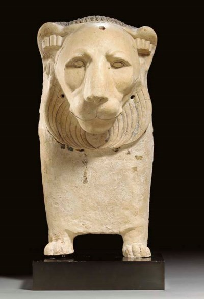 AN EGYPTIAN PLASTER LION