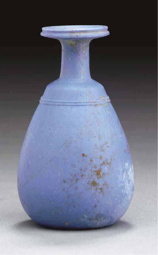 A GREEK GLASS BOTTLE
