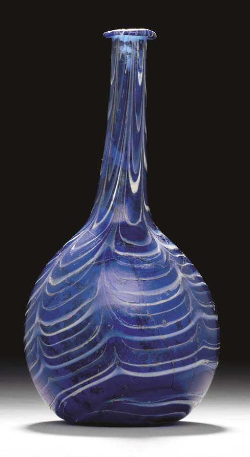 A ROMAN MARBLED GLASS BOTTLE