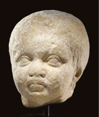 A ROMAN MARBLE HEAD OF A CHILD