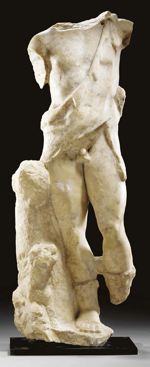 A ROMAN MARBLE FIGURE OF BACCH