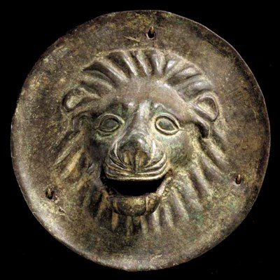 A ROMAN BRONZE LION HEAD PLAQU