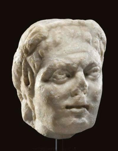 A ROMAN MARBLE HEAD OF A CENTA