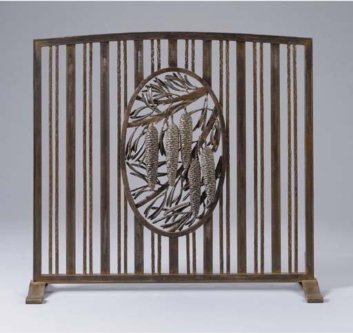 A WROUGHT-IRON FIRESCREEN