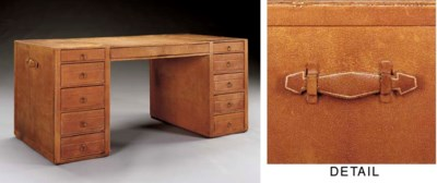 A LEATHER COVERED DESK