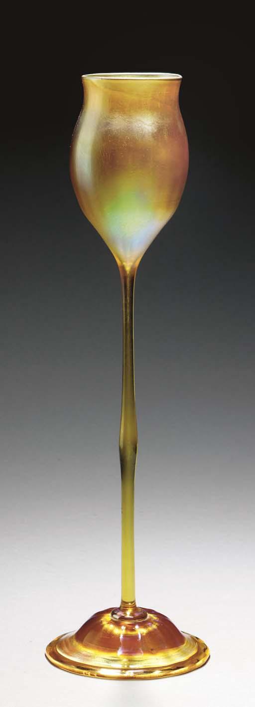 A GOLD FAVRILE GLASS FLORIFORM