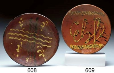 A SLIP DECORATED REDWARE PLATE