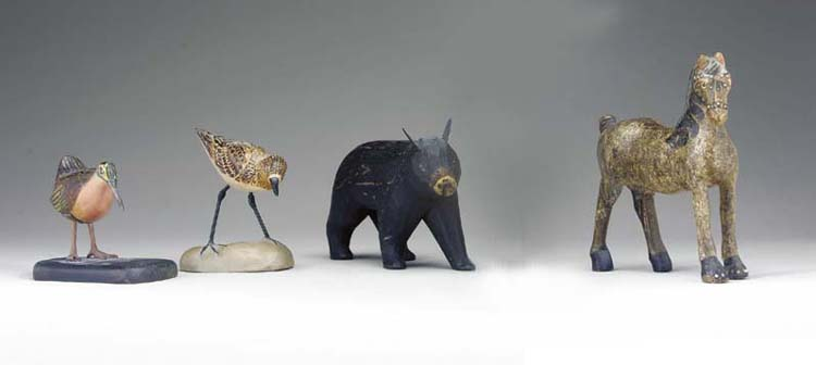 A GROUP OF MINIATURE CARVED AND PAINTED ANIMALS