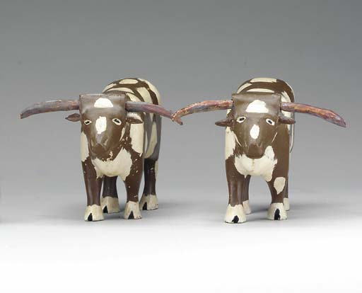 A PAIR OF CARVED AND PAINTED OXEN