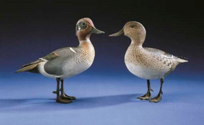 A PAIR OF STANDING GREENWING T