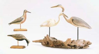 A HERON AND EGRET TOGETHER WIT
