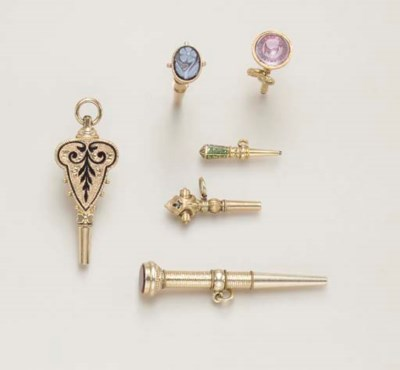 A GROUP OF GOLD WATCH KEYS
