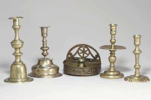 A GROUP OF FIVE BRASS CANDLEST