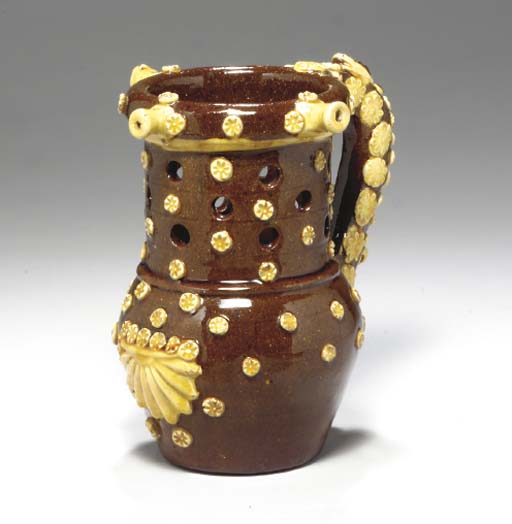 AN ENGLISH REDWARE PUZZLE JUG,