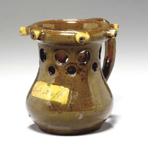 A STAFFORDSHIRE REDWARE OLIVE-