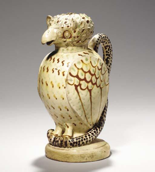 A REDWARE POTTERY OWL JUG,