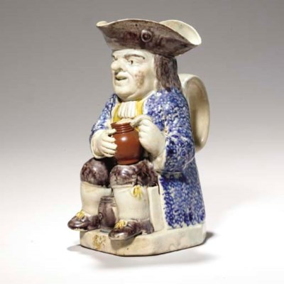 A STAFFORDSHIRE PEARLWARE TOBY