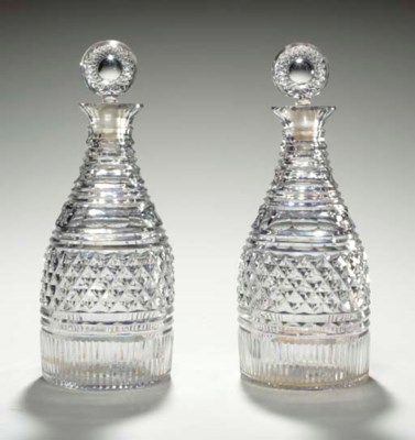 A PAIR OF IRISH CUT GLASS WHIS