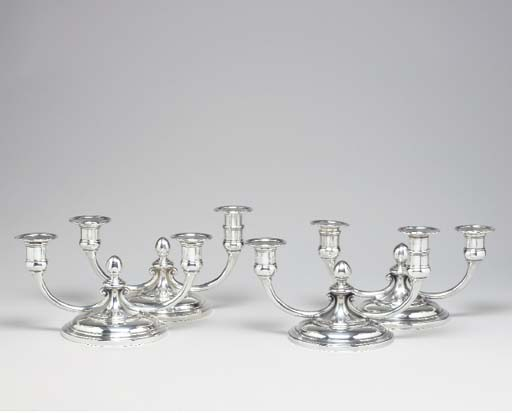 A SET OF FOUR SILVER CANDELABR