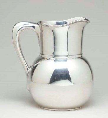 AN AMERICAN SILVER WATER PITCH