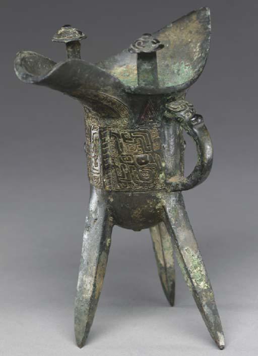 An Archaic bronze tripod wine