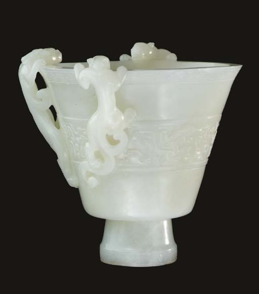 A white jade libation cup,