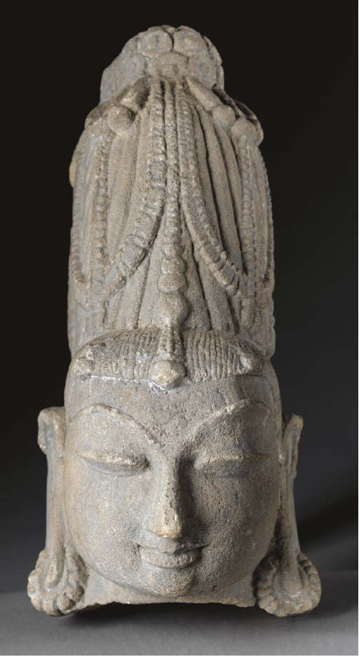 A Sandstone Head of a Deity