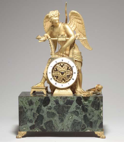 AN EMPIRE ORMOLU MANTEL CLOCK,