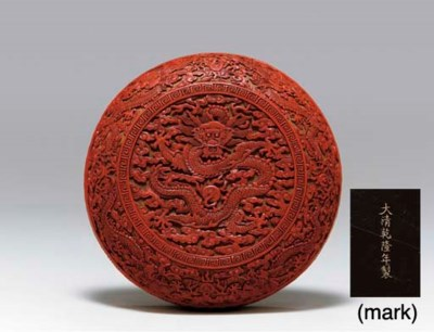 A RARE CARVED RED LACQUER CIRC