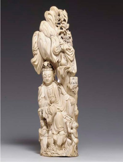 **A LARGE IVORY CARVING OF GUA