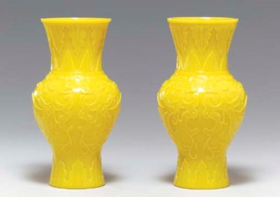 A PAIR OF CARVED LEMON-YELLOW
