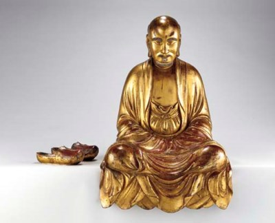 A GILT-LACQUER WOOD FIGURE OF