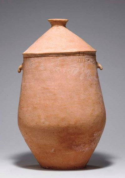 A RARE LARGE RED POTTERY JAR A