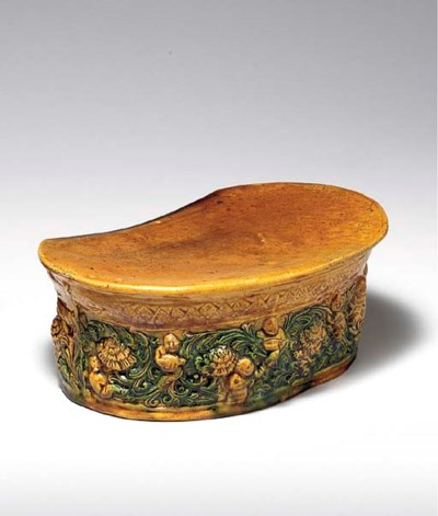 AN AMBER AND GREEN-GLAZED MOLD