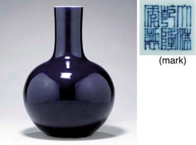 A FINE LARGE BLACKISH-BLUE-GLA